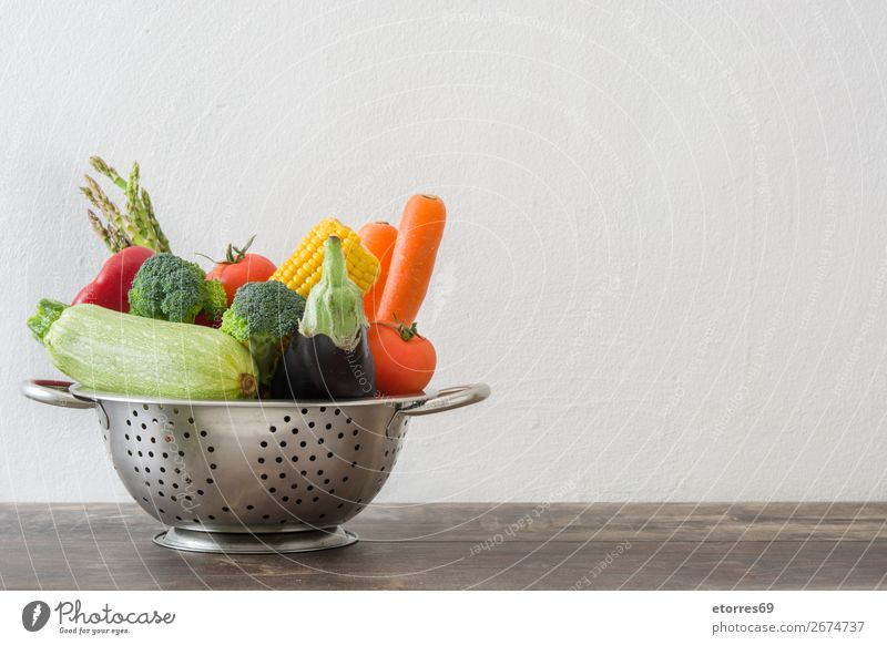 Colander with vegetables on wooden table Diet Healthy Healthy Eating Sieve Food Food photograph Dish Fruit Vegetable Table Wood Vitamin Lettuce Pepper Onion