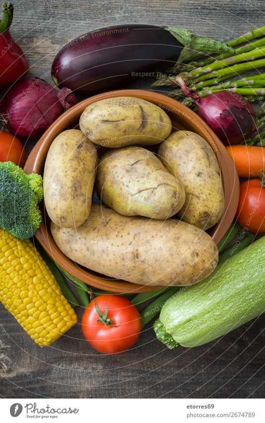 Vegetables and fruit on wood Food Healthy Eating Food photograph Fruit Nutrition Vegetarian diet Diet Multicoloured Yellow Green Red Zucchini Tomato Maize Onion