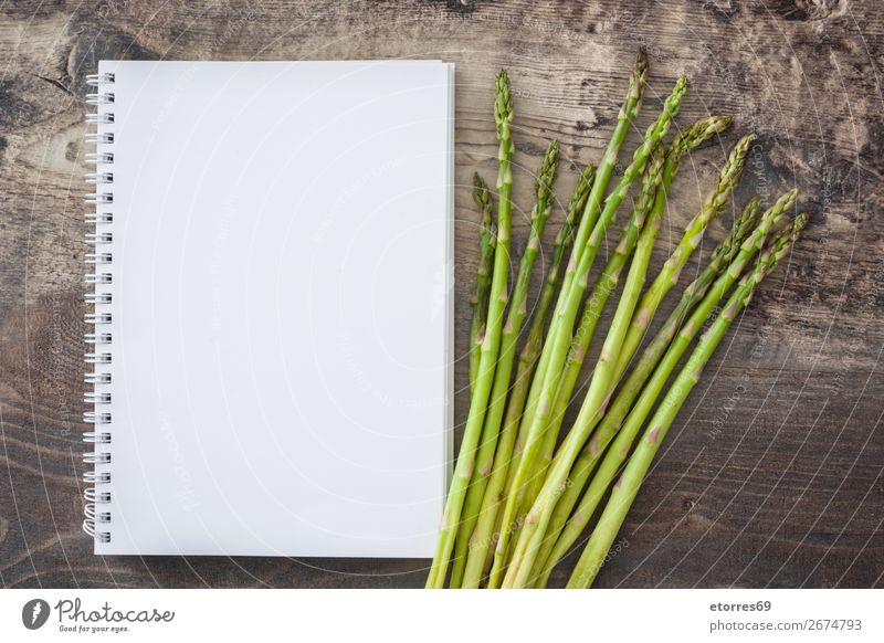 Raw green asparagus and notebook Asparagus Vegetable Green Vegetarian diet Agriculture antioxidant bunch Cooking Diet Crops Dinner Farm Garden Growth Healthy