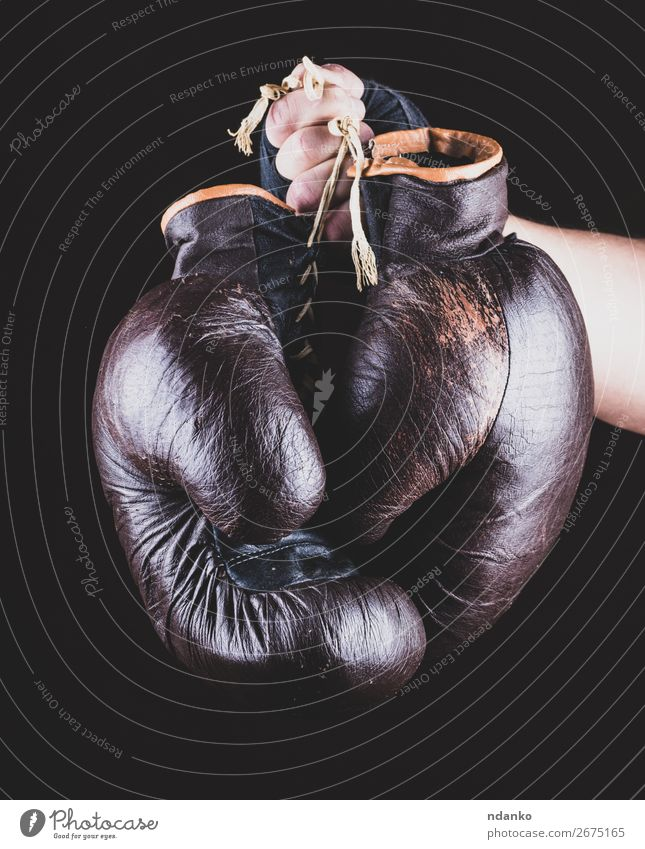 pair of leather sports boxing gloves in hand Sports Success Hand Leather Gloves Old Fitness Brown Black Power Protection Competition boxer Boxing equipment