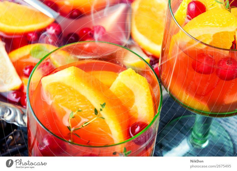 Sangria in glasses sangria alcohol punch drink wineglass orange fruit cranberries cold beverage juice cocktail fresh summer refreshment sweet lemon citrus