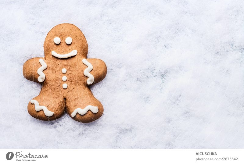 Gingerbread man on snow Food Dough Baked goods Chocolate Nutrition Banquet Shopping Style Design Winter Snow Party Event Feasts & Celebrations