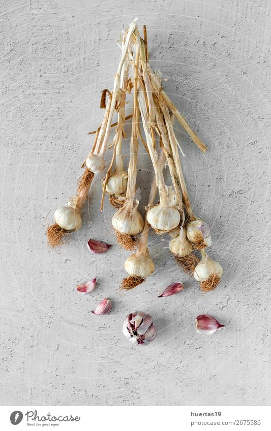 Bouquet of fresh purple garlic Food Vegetable Herbs and spices Nutrition Art Fresh Delicious Natural Above White Garlic background flat lay bulb Agriculture