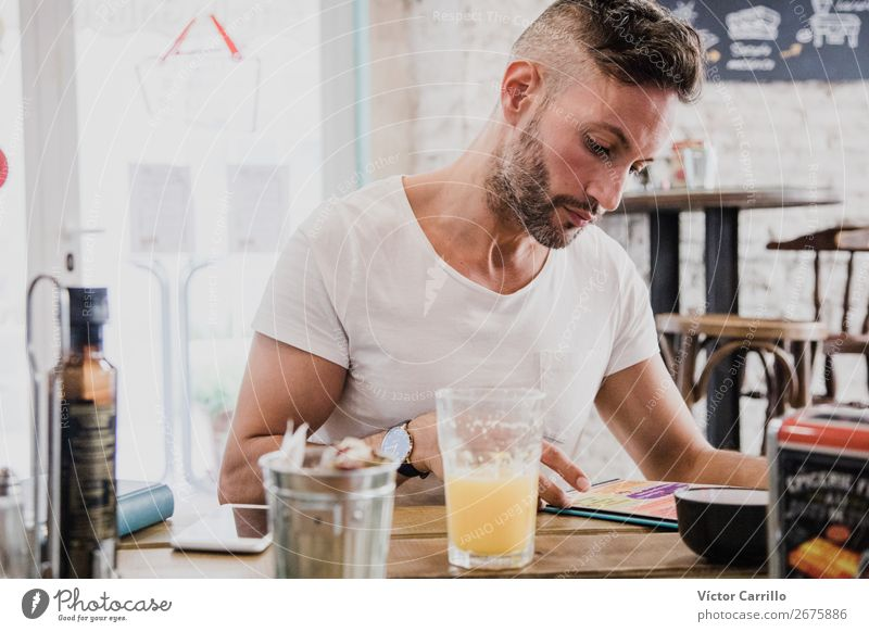A young Man in an urban cafe Beverage Drinking Juice Human being Masculine Young man Youth (Young adults) Adults 1 18 - 30 years Modern Moody Safety