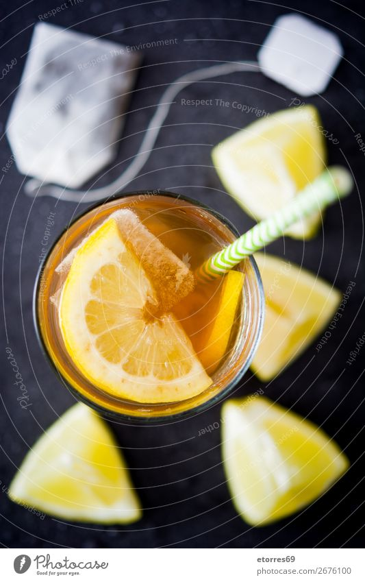 Traditional iced tea with lemon and ice in tall glass Iced tea Lemon Tea Beverage Summer Food Healthy Eating Food photograph Cold Juice Fresh Mint Orange Fruit