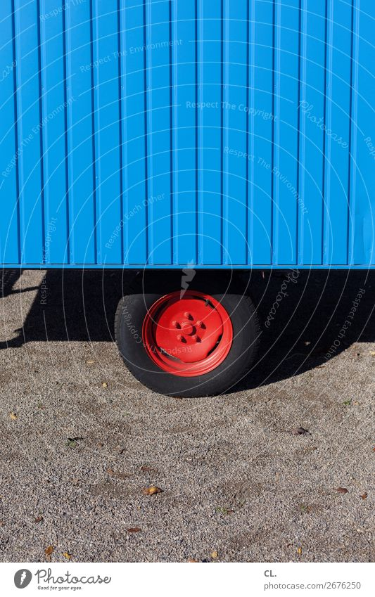 red rim Transport Means of transport Road traffic Lanes & trails Vehicle Site trailer Wheel rim Tire Uniqueness Round Blue Red Colour Mobility Stagnating