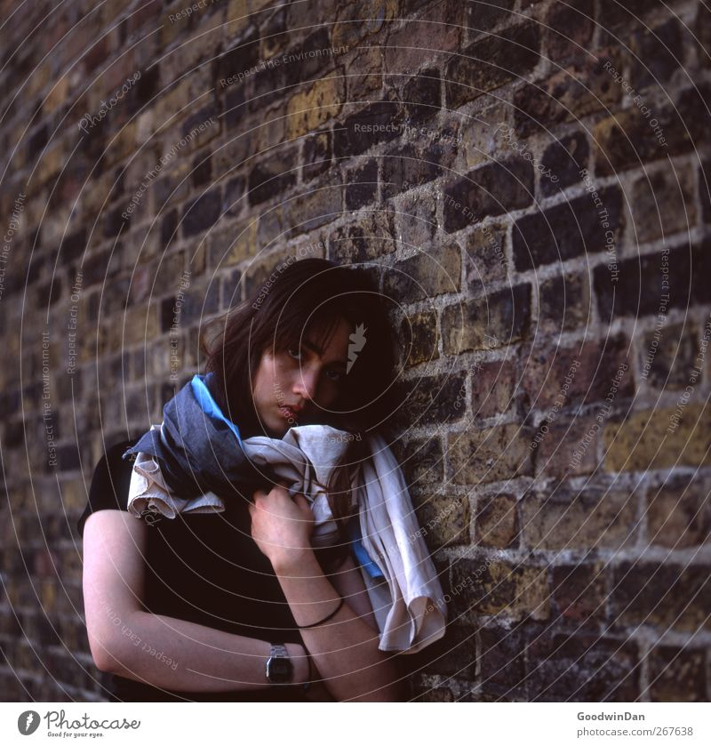 One more thing. Human being Feminine 1 London Town Wall (barrier) Wall (building) Facade Stand Wait Authentic Beautiful Cold Moody Colour photo Exterior shot