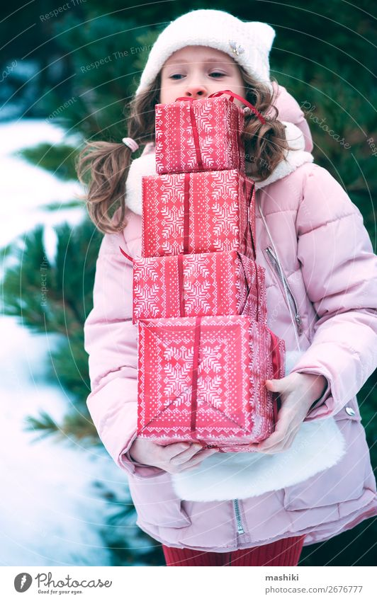 happy kid girl playing outdoor with christmas gifts Lifestyle Joy Happy Playing Vacation & Travel Winter Snow Feasts & Celebrations Christmas & Advent Child