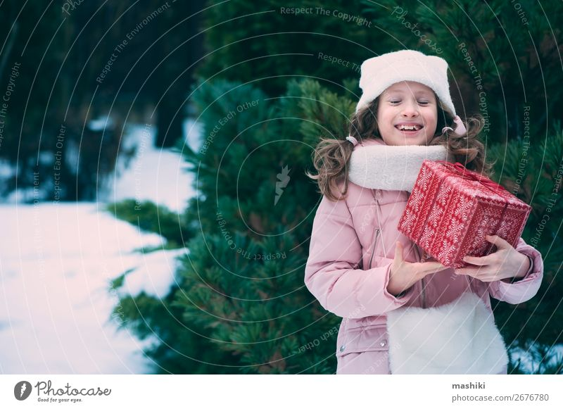 happy kid girl playing outdoor with christmas gifts Child Vacation & Travel Nature Christmas & Advent Joy Winter Lifestyle Funny Snow Happy