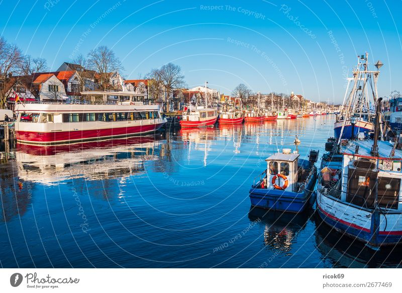 Fishing boats on the old river in Warnemünde Relaxation Vacation & Travel Tourism Ocean Winter Nature Landscape Water Cloudless sky Coast Architecture