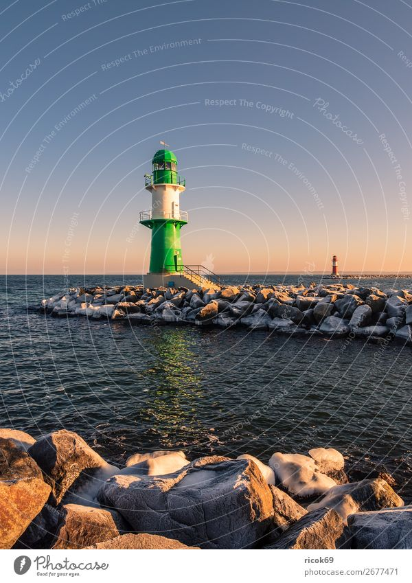 The pier in Warnemünde in winter Relaxation Vacation & Travel Tourism Ocean Winter Nature Landscape Water Clouds Coast Baltic Sea Tower Lighthouse Architecture