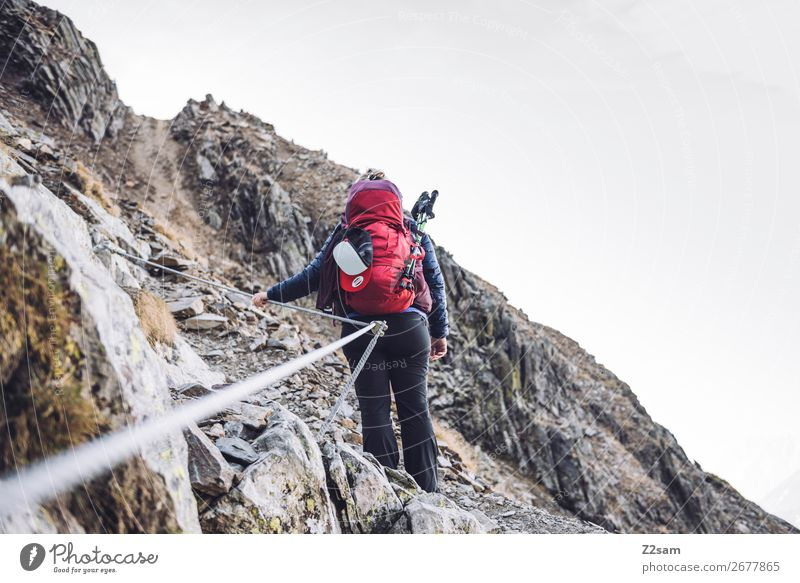Young woman on the via ferrata Leisure and hobbies Vacation & Travel Expedition Hiking Climbing Mountaineering Youth (Young adults) 18 - 30 years Adults Nature