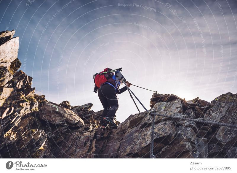 Young woman on the via ferrata Leisure and hobbies Freedom Expedition Mountain Hiking Climbing Mountaineering Youth (Young adults) Nature Landscape Sky