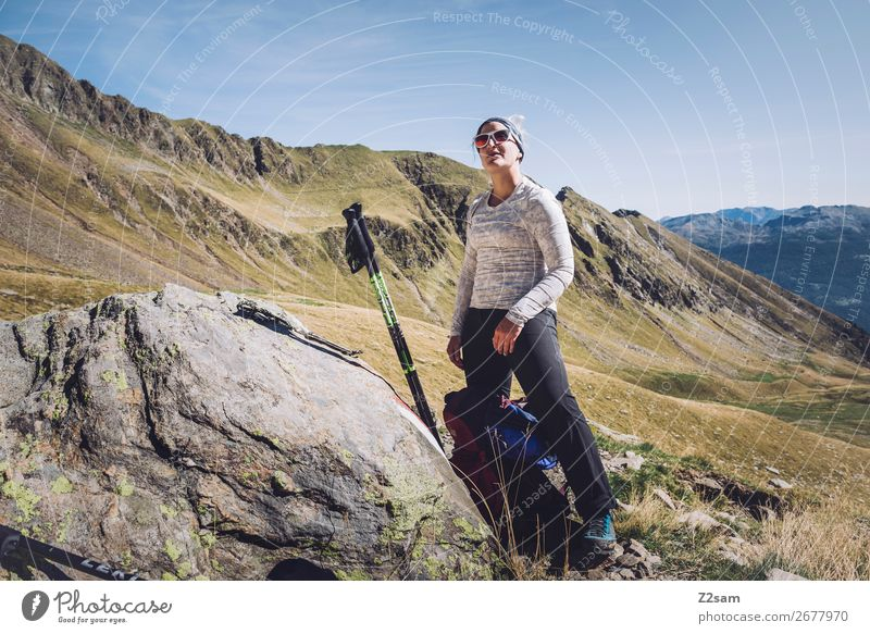 Young woman takes a break while hiking Leisure and hobbies Vacation & Travel Expedition Hiking Climbing Mountaineering Youth (Young adults) Nature Landscape Sun