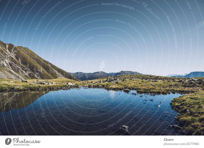Mountain lake on the South Tyrolean Hirzer | E5 Hiking Climbing Mountaineering Nature Landscape Cloudless sky Summer Beautiful weather Alps Peak Lake Esthetic