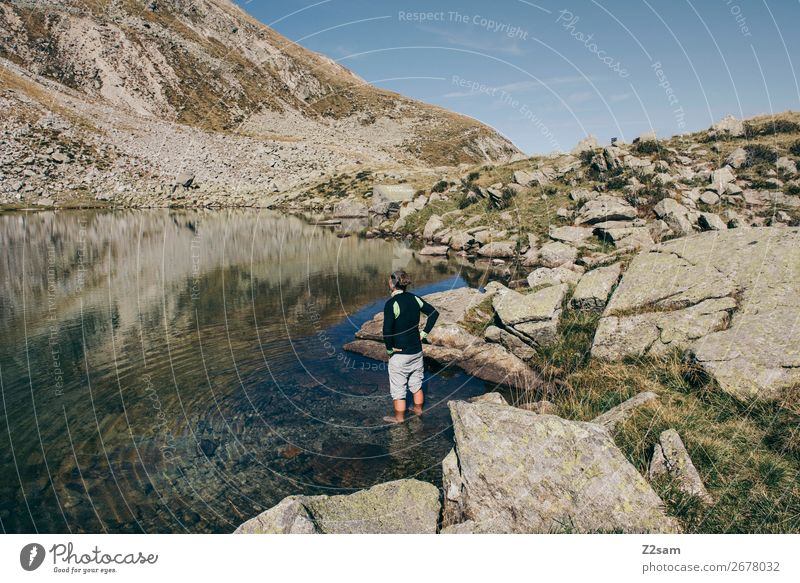 Young man in the water of a mountain lake in South Tyrol Leisure and hobbies Vacation & Travel Expedition Summer Hiking Climbing Mountaineering