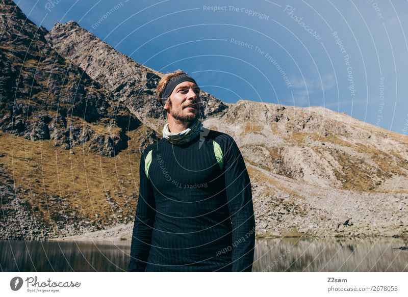 Young man hiking Lifestyle Vacation & Travel Freedom Mountain Hiking Climbing Mountaineering Youth (Young adults) Nature Landscape Summer Beautiful weather Alps