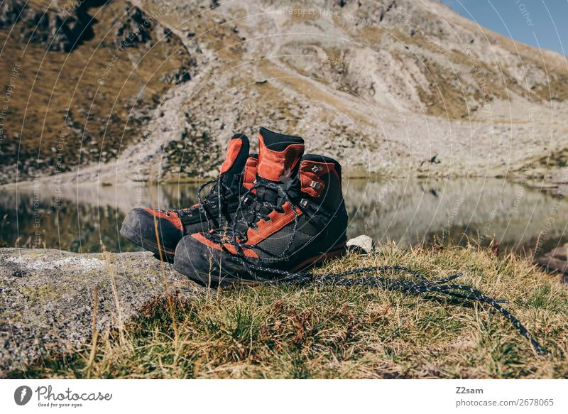 Hiking boots in front of mountain panorama Mountain Climbing Mountaineering Nature Landscape Summer Beautiful weather Meadow Rock Alps Peak Mountain lake Boots