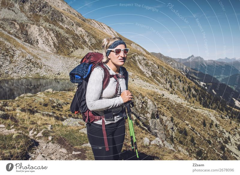 Young woman crossing the Alps | E5 long-distance hiking trail Vacation & Travel Adventure Expedition Mountain Hiking Climbing Mountaineering