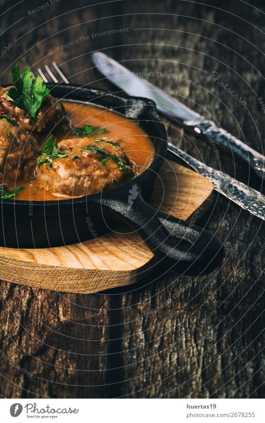 Homemade Albondigas with Spanish sauce Food Meat Sausage Herbs and spices Nutrition Lunch Dinner Buffet Brunch Italian Food Fork Art Delicious Above Red