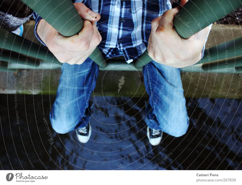 Human being Blue Water Hand Calm Loneliness Relaxation Cold Legs Leisure and hobbies Sit Masculine Bridge Safety River Jeans