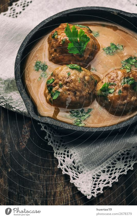 Homemade Albondigas with Spanish sauce Food Meat Herbs and spices Lunch Italian Food Crockery Fork Art Delicious Natural Red Tradition meatballs Sauce stew