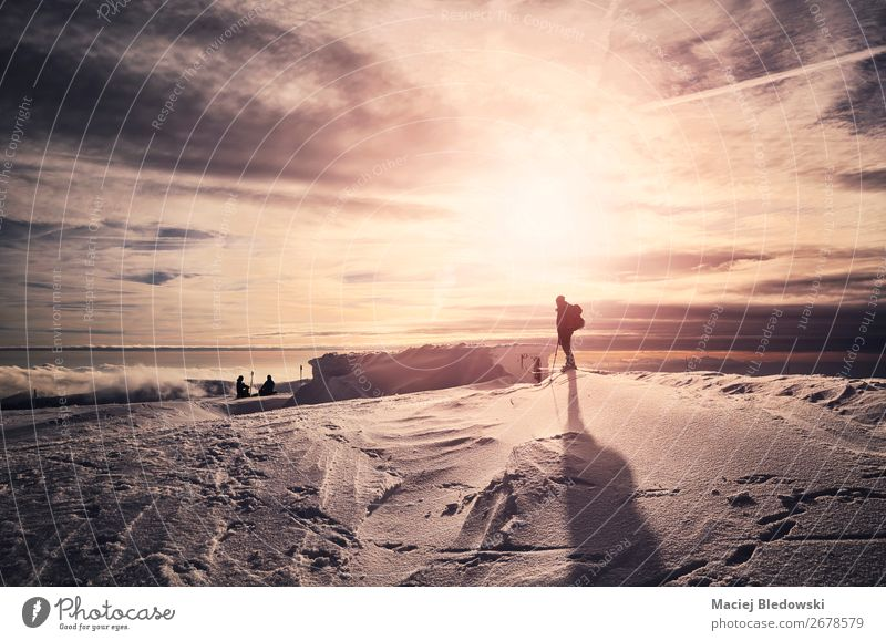 Winter mountains with resting skiers silhouettes at sunset. Lifestyle Beautiful Relaxation Vacation & Travel Trip Adventure Freedom Expedition Sun Snow Mountain