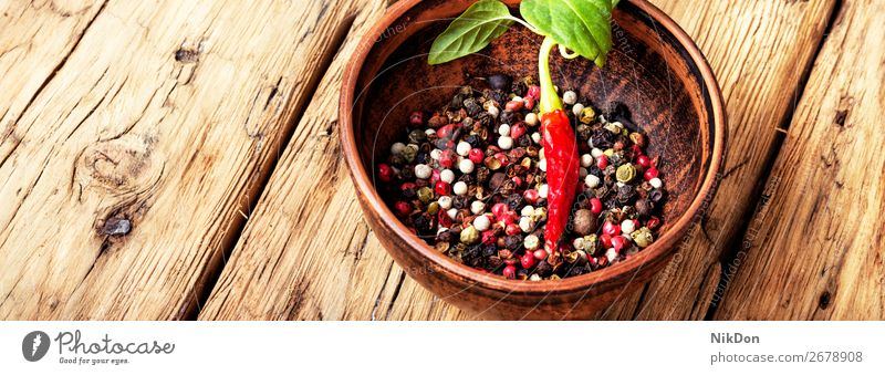 Different kinds of peppercorns. spice mexican ingredient seasoning pea healthy spicy black chili clay bowl vegetable closeup kitchen hot cayenne ripe paprika