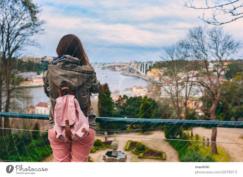 Tourist woman visiting Porto, Portugal. Lifestyle Vacation & Travel Tourism Adventure Sightseeing Woman Adults Culture Landscape River Town Bridge Building
