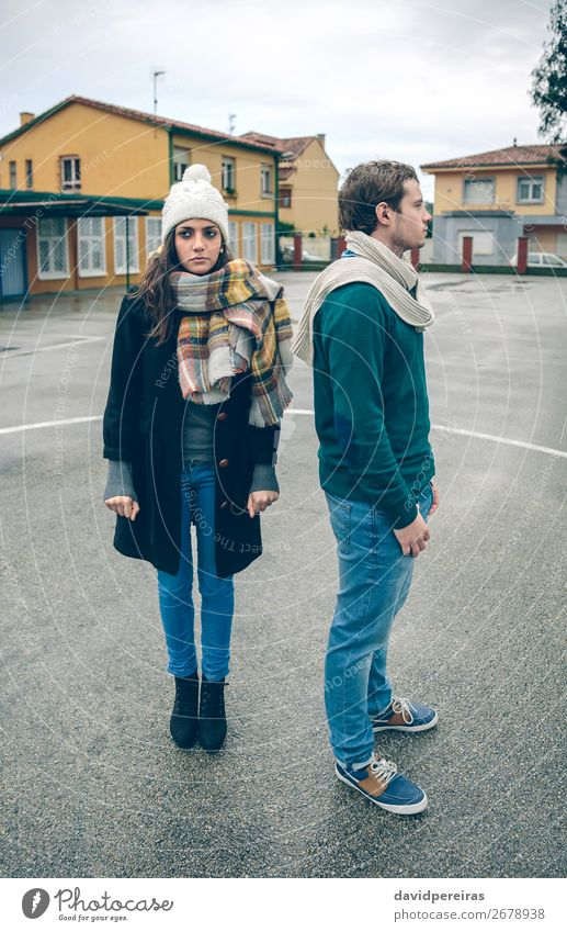 Portrait of couple wearing winter clothes standing outdoors Lifestyle Beautiful Relaxation Leisure and hobbies Winter Human being Woman Adults Man Friendship