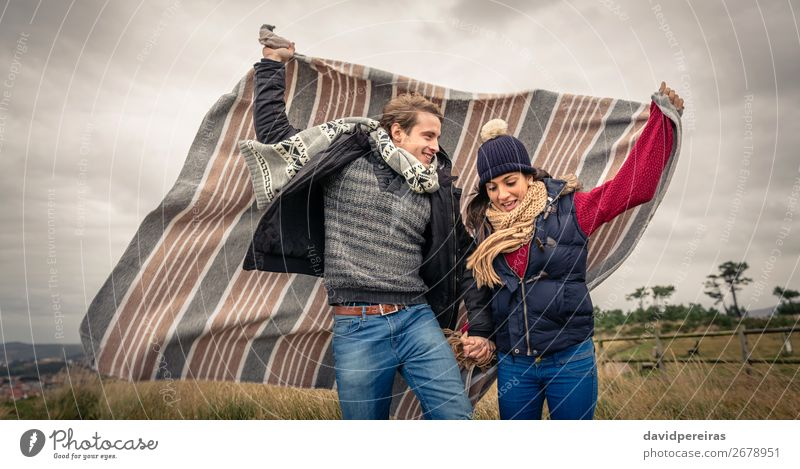 Young couple playing outdoors with blanket in a windy day Lifestyle Joy Happy Beautiful Playing Freedom Winter Mountain Woman Adults Man Couple Nature Sky
