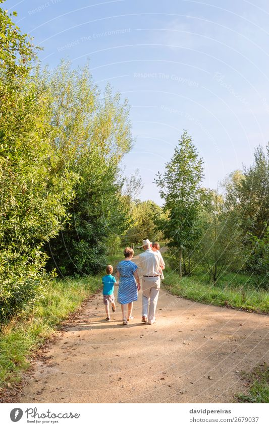 Grandparents and grandchildren walking outdoors Woman Child Nature Man Old Summer Joy Lifestyle Adults Love Family & Relations Happy Boy (child) Together