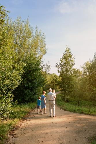 Grandparents and grandchildren walking outdoors Lifestyle Leisure and hobbies Summer Child Human being Baby Boy (child) Woman Adults Man Parents Grandfather