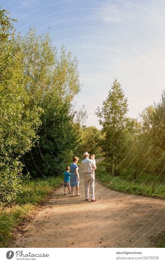 Grandparents and grandchildren walking outdoors Woman Child Human being Nature Man Old Summer Landscape Lifestyle Adults Love Family & Relations Boy (child)