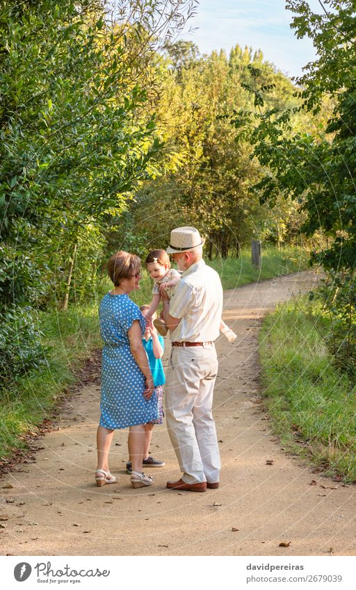 Grandparents and grandchildren walking outdoors Lifestyle Joy Happy Leisure and hobbies Summer Child Baby Boy (child) Woman Adults Man Parents Grandfather