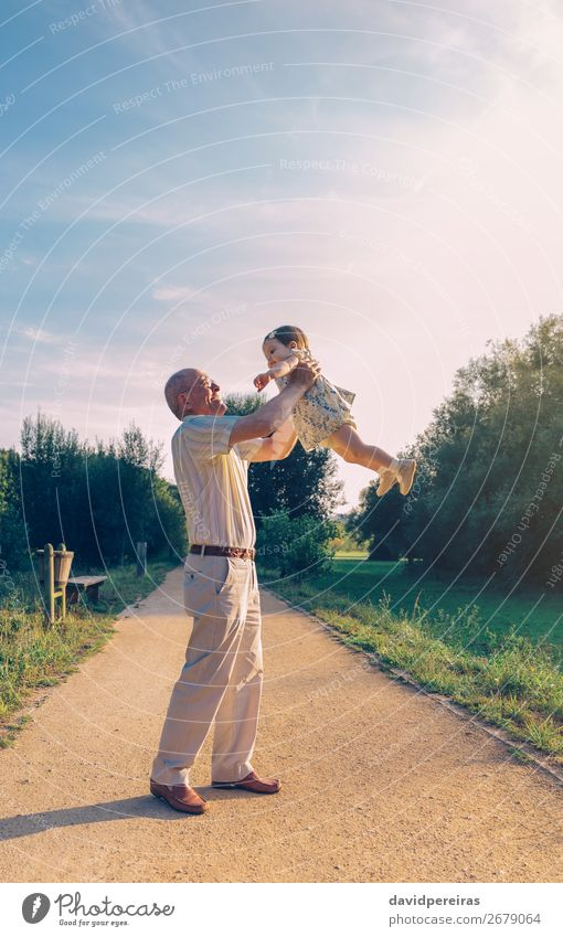 Senior man playing with baby girl Lifestyle Happy Relaxation Leisure and hobbies Playing Summer Human being Baby Toddler Woman Adults Man Parents Grandfather