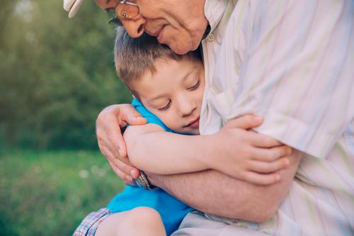 Happy grandson hugging grandfather over a nature outdoor background Lifestyle Relaxation Leisure and hobbies Summer Garden Child Human being Boy (child) Man