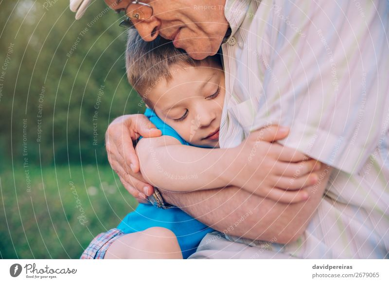 Happy grandson hugging to his grandfather outdoors Lifestyle Relaxation Leisure and hobbies Summer Garden Child Human being Boy (child) Man Adults Parents