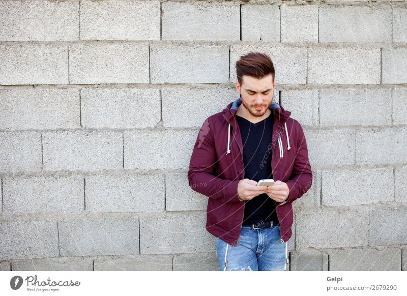 Cool young man with beard looking the mobile Lifestyle Style Summer Human being Man Adults Street Fashion Jeans Piercing Beard Cool (slang) Eroticism