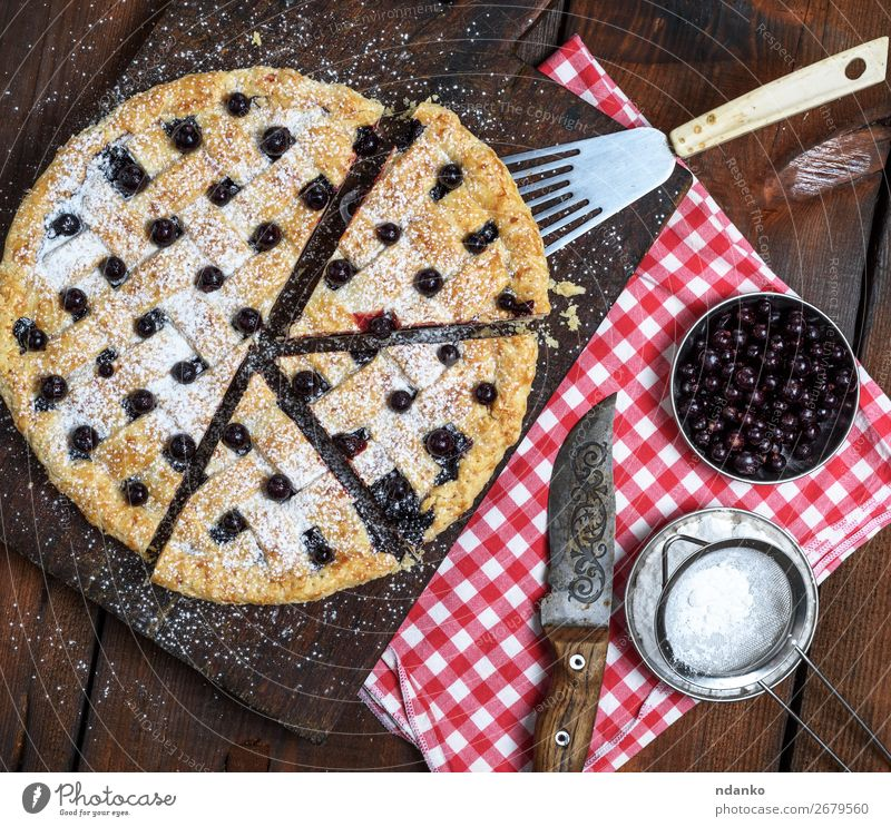 baked round black currant cake cut into pieces Fruit Dough Baked goods Cake Dessert Candy Nutrition Table Wood Fresh Delicious Above Brown Red Black White