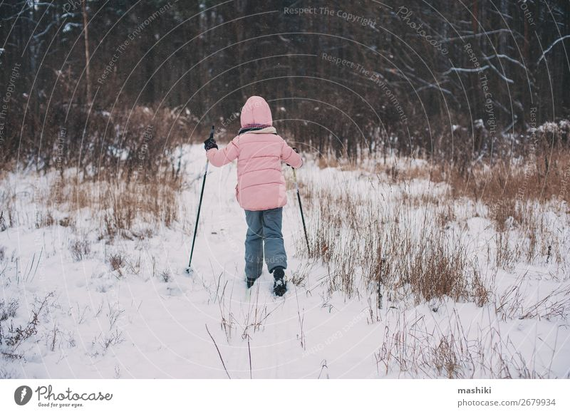 happy child girl skiing in winter snowy forest Joy Leisure and hobbies Vacation & Travel Adventure Winter Snow Winter vacation Sports Skis Child Girl Landscape