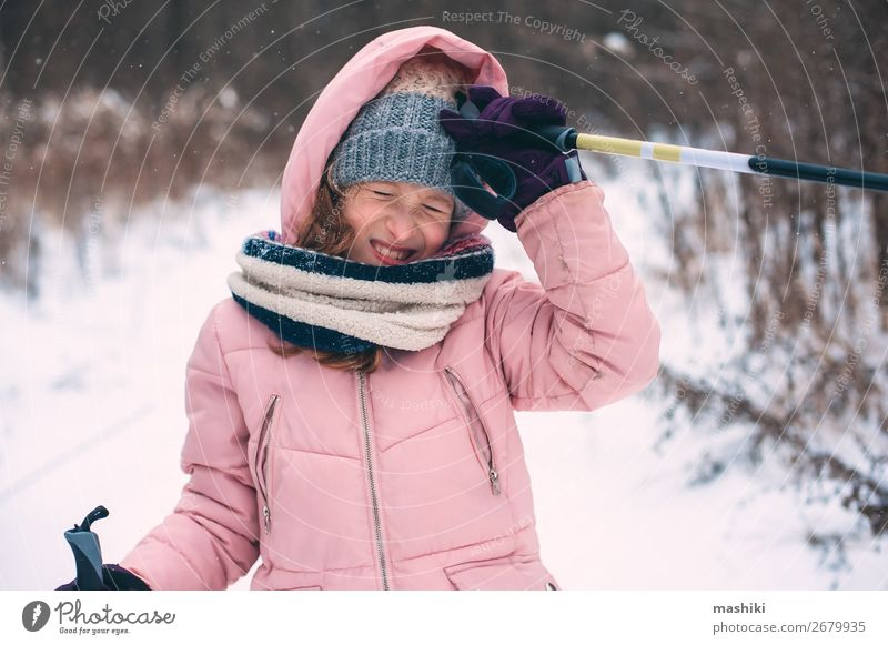happy child girl skiing in winter snowy forest Joy Leisure and hobbies Vacation & Travel Adventure Winter Snow Winter vacation Sports Skis Child Girl