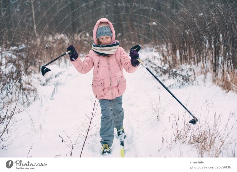 happy child girl skiing in winter snowy forest Leisure and hobbies Vacation & Travel Adventure Winter Snow Winter vacation Skis Child Youth (Young adults)