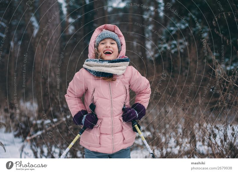 happy child girl skiing in winter snowy forest Child Vacation & Travel Youth (Young adults) Landscape Joy Forest Winter Snow Sports Leisure and hobbies Wild