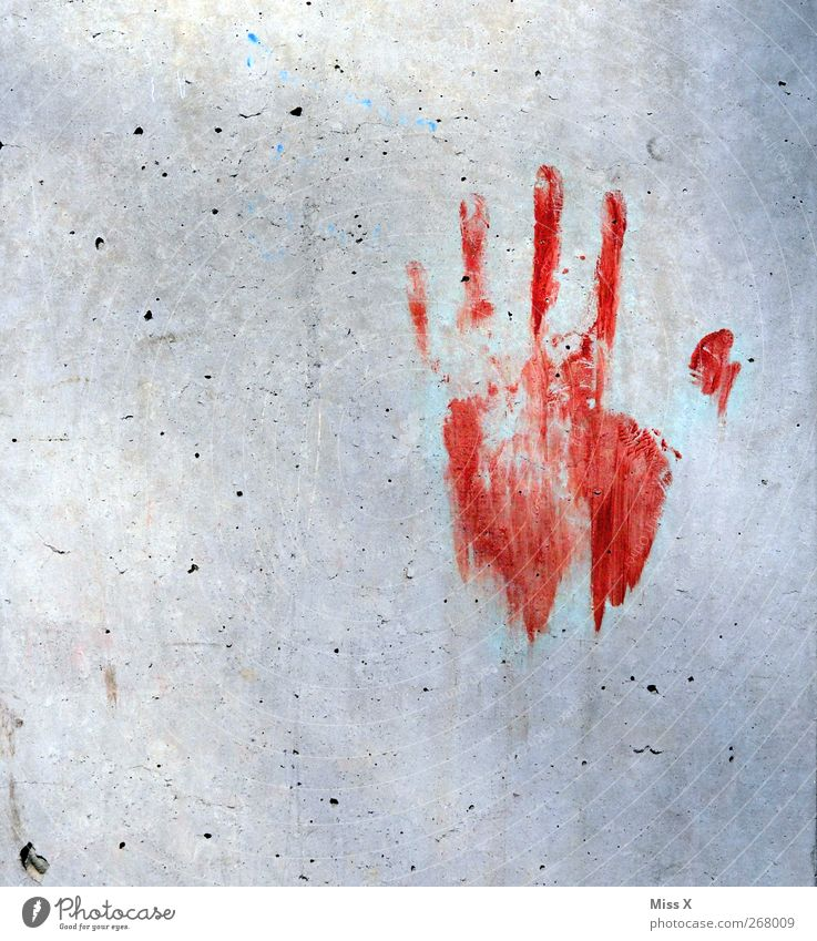 the dear neighbour is back Hand Fingers Wall (barrier) Wall (building) Dirty Red Fear Horror Fear of death Dangerous Imprint Murder Criminality Colour photo
