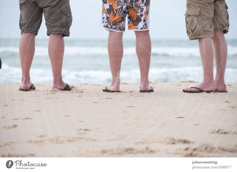 Human being Youth (Young adults) Vacation & Travel Ocean Summer Life Coast Sand Group Legs Waves Tourism Stand Young man Summer vacation Tourist