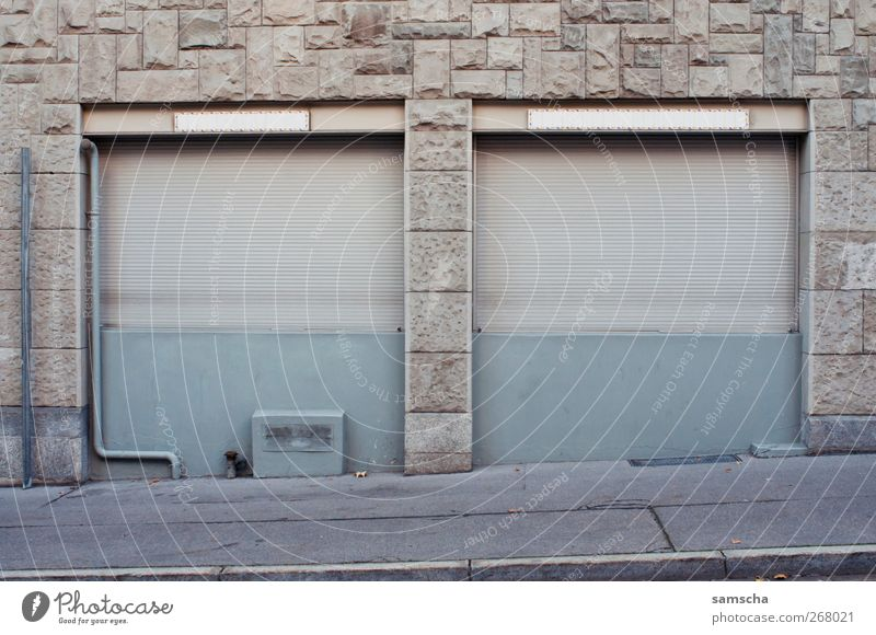 roller shutter Trade Small Town Pedestrian precinct Building Wall (barrier) Wall (building) Facade Window Old Gray End Apocalyptic sentiment Roller shutter