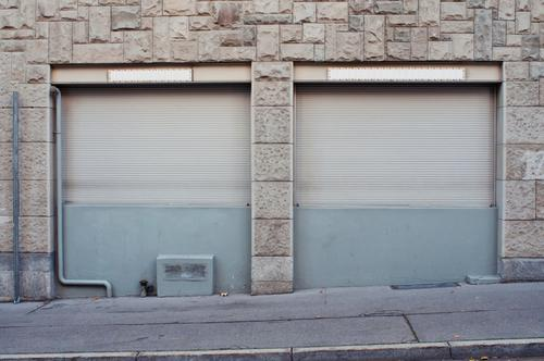 roller shutter Trade Small Town Pedestrian precinct Building Wall (barrier) Wall (building) Facade Window Old Gray End Apocalyptic sentiment Roller shutter