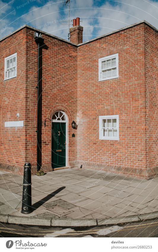 Traditional house facade in England. Town White Red House (Residential Structure) Street Architecture Wall (building) Building Wall (barrier) Orange Brown