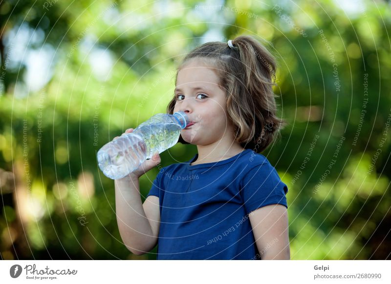 Cute little girl with water bottle Beverage Bottle Lifestyle Happy Beautiful Leisure and hobbies Summer Child Human being Woman Adults Infancy Hand Nature Park